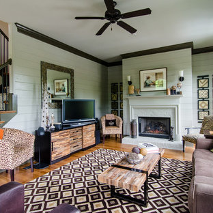 Living room - transitional medium tone wood floor living room idea in Atlanta with a tv stand