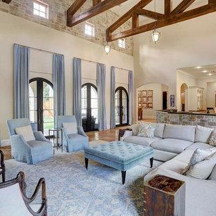 ヒューストンの広い地中海スタイルのおしゃれなLDK (フォーマル、白い壁、セラミックタイルの床、暖炉なし、テレビなし) の写真