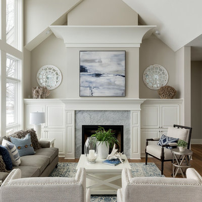 Elegant formal and open concept medium tone wood floor living room photo in Minneapolis with gray walls, a standard fireplace and a stone fireplace