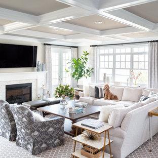 Inspiration pour un salon traditionnel avec un mur beige, un sol en bois foncé, une cheminée standard, un téléviseur fixé au mur et un sol marron.