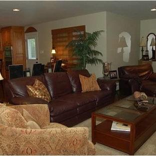 Immagine di un ampio soggiorno chic aperto con sala della musica, pareti verdi, parquet scuro, camino classico, cornice del camino piastrellata e TV autoportante
