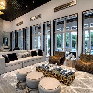 Esempio di un ampio soggiorno tradizionale aperto con pavimento grigio, pareti bianche, pavimento in gres porcellanato, camino lineare Ribbon, cornice del camino in metallo e nessuna TV