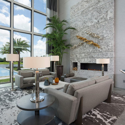 Large trendy formal porcelain tile and gray floor living room photo in Miami with gray walls and a ribbon fireplace