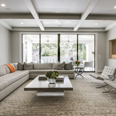 Inspiration for a large contemporary formal and open concept dark wood floor living room remodel in Dallas with gray walls