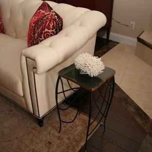 ジャクソンビルの大きいトランジショナルスタイルのおしゃれなLDK (ベージュの壁、コーナー設置型暖炉、タイルの暖炉まわり、テレビなし、茶色い床) の写真