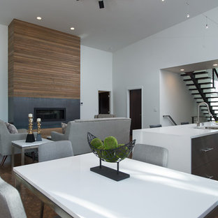 Inspiration for a large modern open concept concrete floor living room remodel in Seattle with white walls, a ribbon fireplace, a wood fireplace surround and no tv