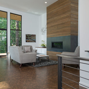 Large minimalist open concept concrete floor living room photo in Seattle with white walls, a ribbon fireplace, a wood fireplace surround and no tv