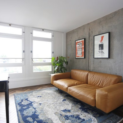 Urban dark wood floor living room photo in London with white walls, no fireplace and a wall-mounted tv
