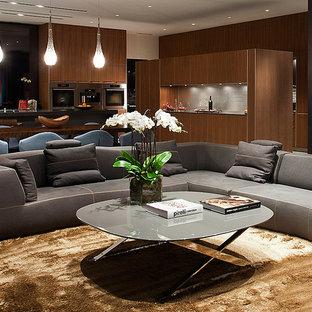 Modelo de salón para visitas abierto, moderno, grande, sin chimenea y televisor, con paredes negras y suelo vinílico