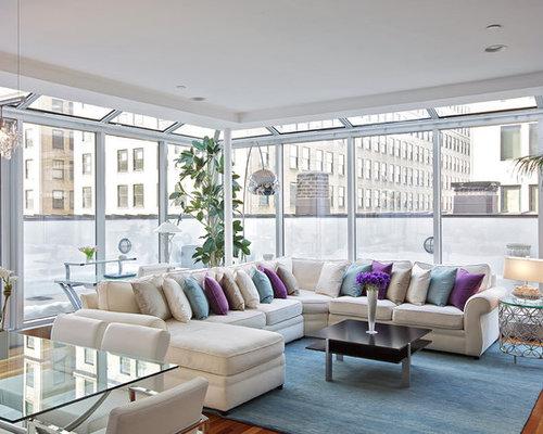 Contemporary Medium Tone Wood Floor Living Room Idea In New York
