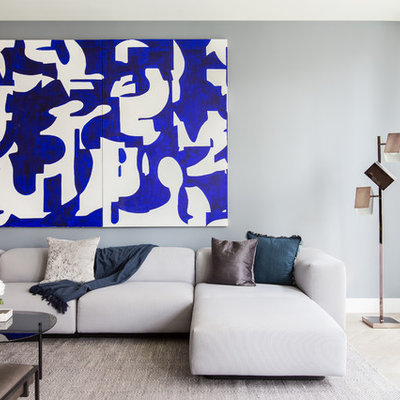Inspiration for a contemporary formal beige floor living room remodel in New York with gray walls