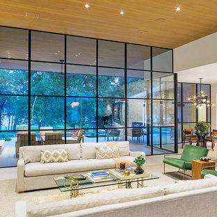 オースティンの大きいコンテンポラリースタイルのおしゃれなLDK (白い壁、標準型暖炉、石材の暖炉まわり、白い床、フォーマル、テレビなし) の写真