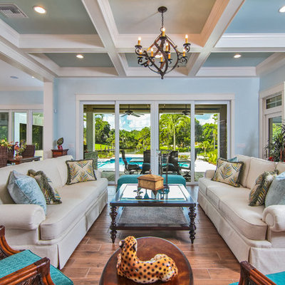 Living room - large tropical formal and open concept dark wood floor living room idea in Miami with blue walls, no fireplace and no tv