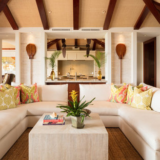Medium sized world-inspired open plan living room in Hawaii with white walls, medium hardwood flooring, a built-in media unit and brown floors.