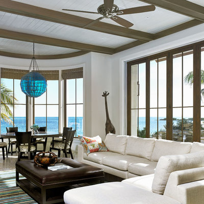 Living room - tropical formal and open concept living room idea in Miami with white walls and no fireplace