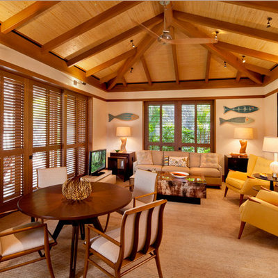 Example of an island style formal carpeted living room design in Hawaii with beige walls, no fireplace and a tv stand