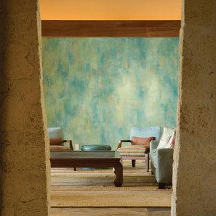 Diseño de salón tropical con suelo de pizarra