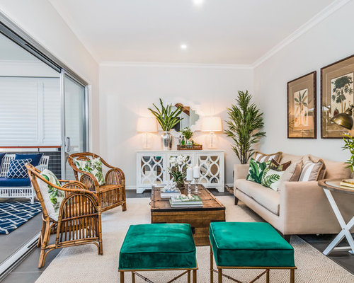 Photo Of A Tropical Living Room In Brisbane With White Walls.
