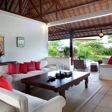 Tropical Living Room by PT Cempaka Interior