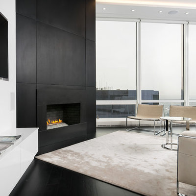 Living room - small contemporary formal and open concept dark wood floor living room idea in Chicago with white walls, a corner fireplace and a wall-mounted tv
