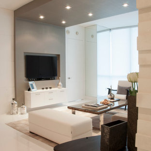 Living room - mid-sized contemporary formal and open concept porcelain floor and white floor living room idea in Miami with white walls, no fireplace and a wall-mounted tv