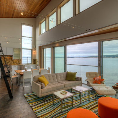 Beach style open concept painted wood floor living room photo in Seattle with white walls