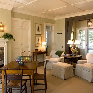 Example of a classic open concept carpeted living room design in Charlotte with beige walls, a wood stove and a stone fireplace