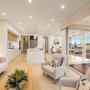シドニーの巨大なビーチスタイルのおしゃれなLDK (白い壁、セラミックタイルの床、暖炉なし、テレビなし、黄色い床) の写真