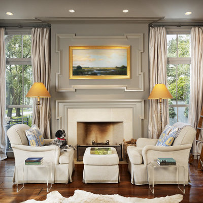 Living room library - mid-sized traditional dark wood floor living room library idea in Houston with gray walls, a standard fireplace and a tile fireplace