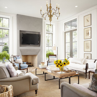 Design ideas for a large country open concept living room in Houston with white walls, brick floors, a standard fireplace, a wall-mounted tv and a concrete fireplace surround.