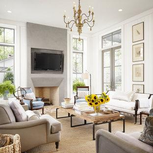 Idee per un grande soggiorno country aperto con pareti bianche, pavimento in mattoni, camino classico, TV a parete e cornice del camino in cemento