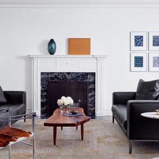 Esempio di un soggiorno chic di medie dimensioni e chiuso con sala formale, pareti bianche, pavimento in legno massello medio, camino classico, nessuna TV e pavimento marrone