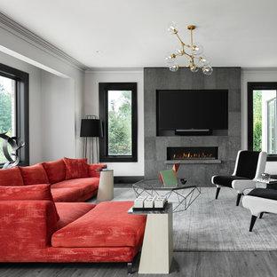 Esempio di un soggiorno classico con pareti grigie, camino lineare Ribbon, cornice del camino piastrellata, TV a parete e pavimento grigio