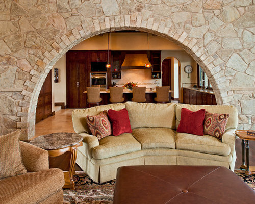 Inspiration For A Mediterranean Open Concept Dark Wood Floor Family Room Remodel In Austin With Beige