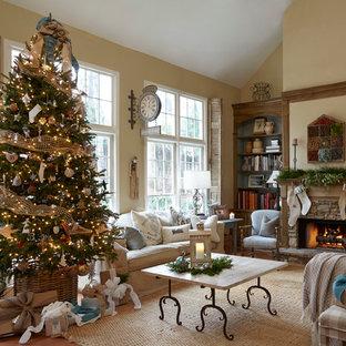 Immagine di un grande soggiorno aperto con pareti beige
