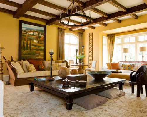 Example Of A Tuscan Living Room Design In DC Metro With Yellow Walls