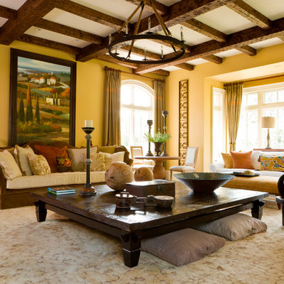 Example of a large tuscan formal and enclosed dark wood floor and brown floor living room design in DC Metro with yellow walls, no fireplace and no tv