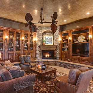 Tuscan living room photo in Other with a corner fireplace and a stone fireplace