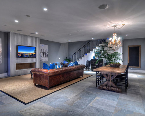 Example Of A Large Coastal Open Concept And Formal Slate Floor Living Room Design In Orange