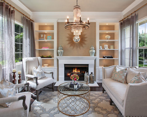 inspiration for a transitional dark wood floor living room remodel in orange county with beige walls