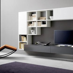 Foto de salón abierto, minimalista, de tamaño medio, con paredes grises y suelo gris