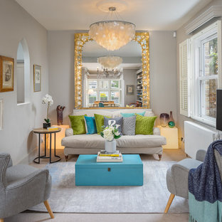 Design ideas for a small traditional enclosed living room in London with grey walls, carpet, a wall mounted tv and beige floors.