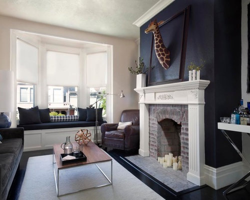 wrap around fireplace mantel. Example of a transitional enclosed living room design in San Francisco with  standard fireplace Dark Wraparound Mantel Houzz