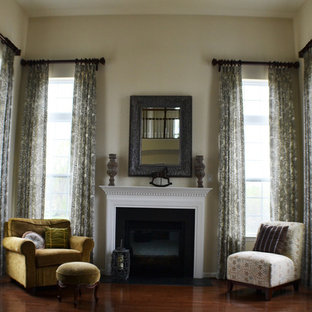 Inspiration for a large contemporary formal and open concept medium tone wood floor living room remodel in Philadelphia with white walls, a standard fireplace and a wood fireplace surround
