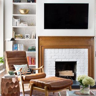 ニューヨークの中サイズのトランジショナルスタイルのおしゃれなLDK (ライブラリー、白い壁、標準型暖炉、レンガの暖炉まわり、壁掛け型テレビ、マルチカラーの床) の写真