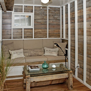 Inspiration for a beach style medium tone wood floor living room remodel in DC Metro with brown walls