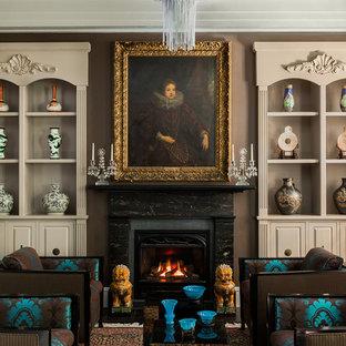 ボストンの中サイズのトラディショナルスタイルのおしゃれな独立型リビング (フォーマル、茶色い壁、標準型暖炉、テレビなし、濃色無垢フローリング、石材の暖炉まわり) の写真
