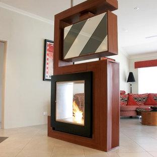 パースの広いインダストリアルスタイルのおしゃれなLDK (フォーマル、白い壁、磁器タイルの床、両方向型暖炉、木材の暖炉まわり、据え置き型テレビ、白い床) の写真