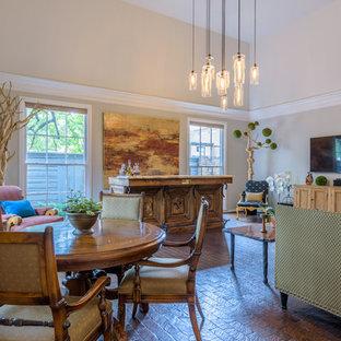 Ispirazione per un grande soggiorno chic aperto con angolo bar, pareti grigie, pavimento in mattoni, parete attrezzata e pavimento marrone
