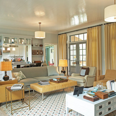 Example of a transitional living room design in New York with blue walls